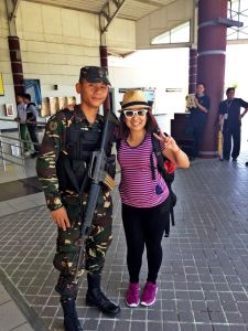 Smiling away with an army soldier guarding the gates of Davao